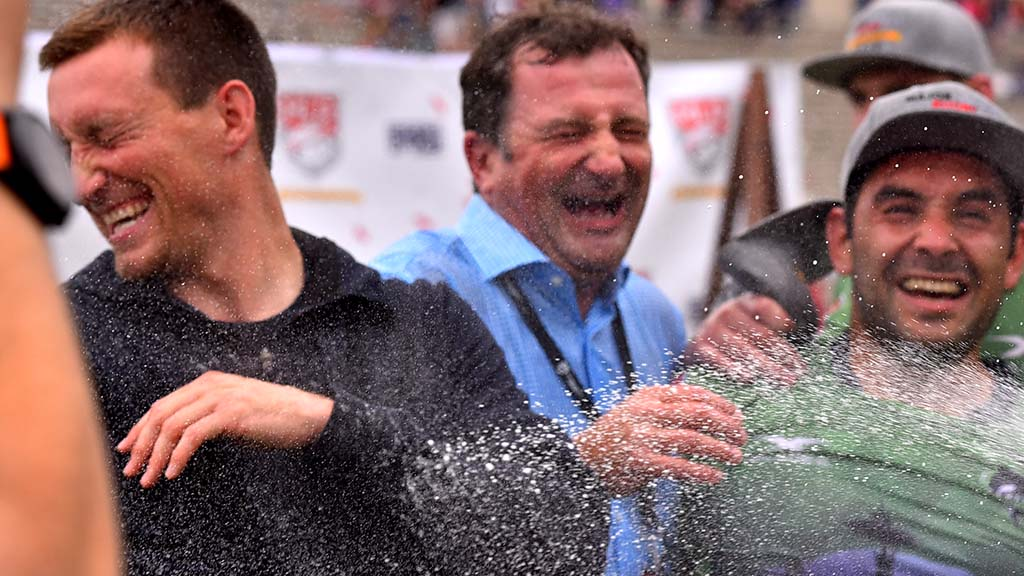 Seattle Seawolves co-owner Adrian Balfour (center) enjoys a spray of champagne during on-field celebration.