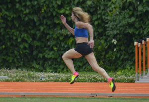 Colleen Barney is all alone at the Pasadena Senior Games, leading the 200-meter dash at the Caltech track.