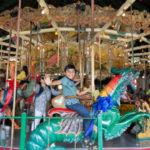 Children riding the Balboa Park Carousel