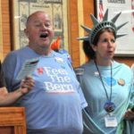 "Jim Boydston (in ""Feel the Bern"" T-shirt) and Josephine Piarulli (as Lady Liberty) are among six people joining lawsuit against the Secretary of State's Office."