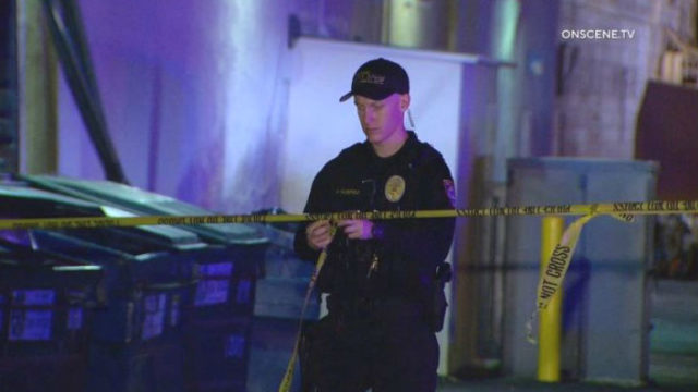 Escondido Police officer strings crime scene tape