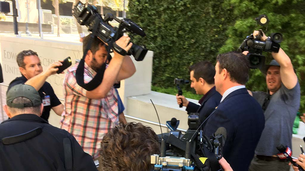 Cameramen surround Rep. Duncan D. Hunter as he heads to car waiting on Broadway after his federal court appearance.