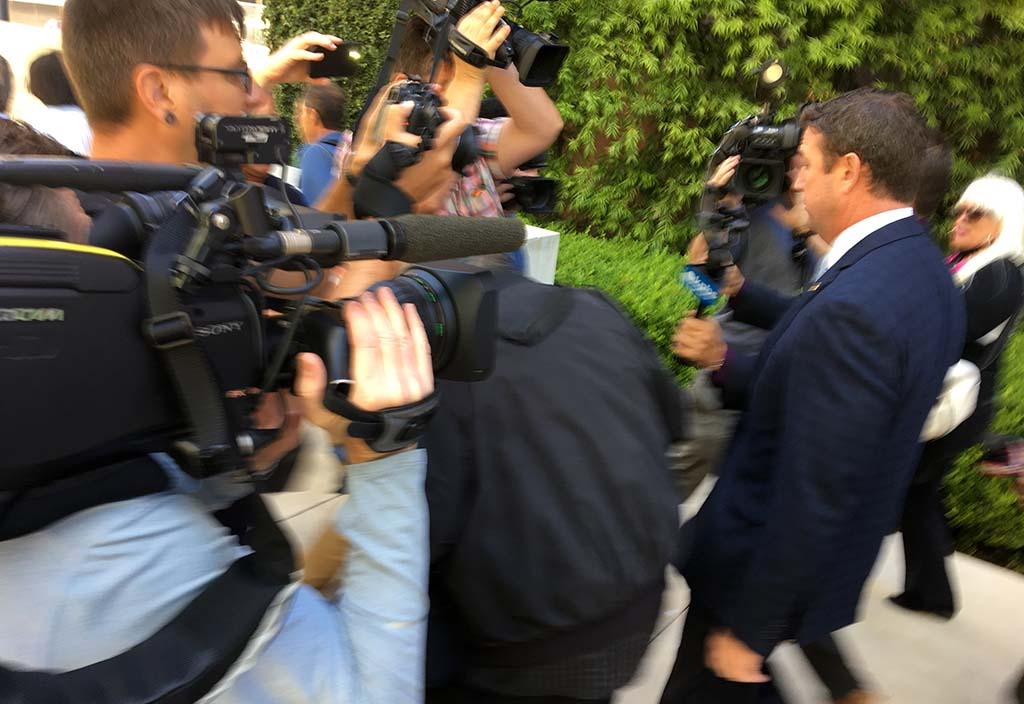 Rep. Duncan D. Hunter navigates a crush of cameramen as he leaves downtown federal court after his motions hearing before Judge Thomas Whelan.