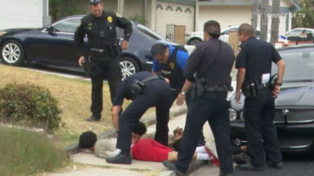 Police make an arrest on July 17 that is believed to be related to the La Jolla party shooting