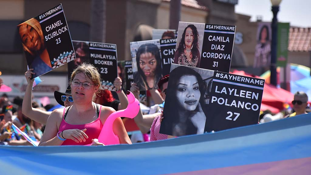People march in honor of transgender woman of color who have been attacked.
