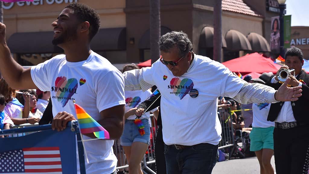 Congressman Juan Vargas follows his custom of dancing down the parade route.