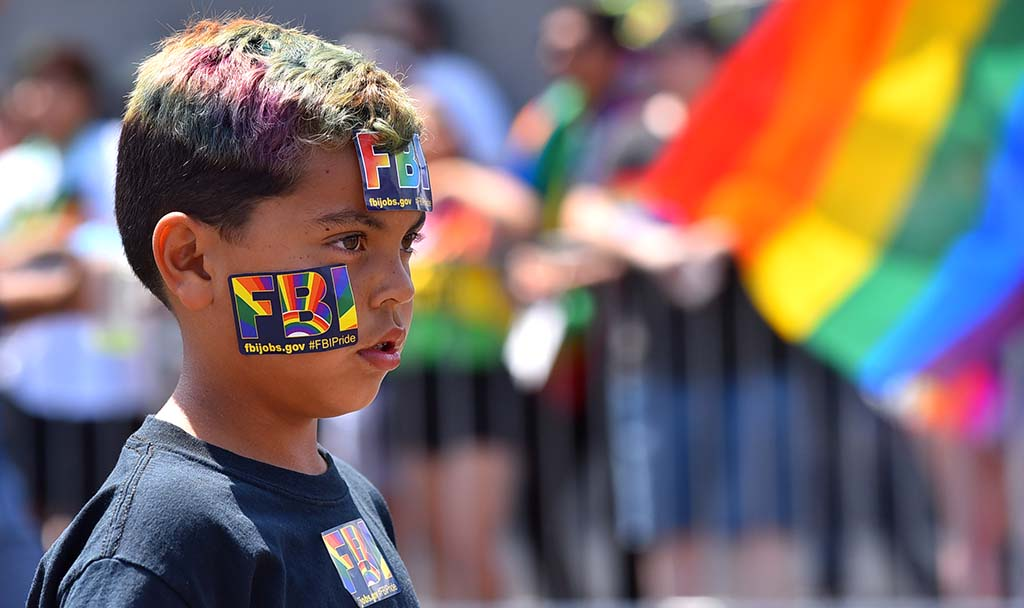 Members of the FBI and their children march in support of the LGBT community.