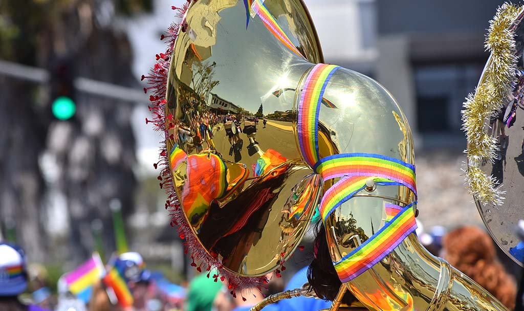 A sousaphone carried by a member of the Pride Youth Marching Band is decorated and reflects the route.