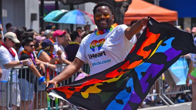 A marcher with the San Diego County Credit Union displays his pride.