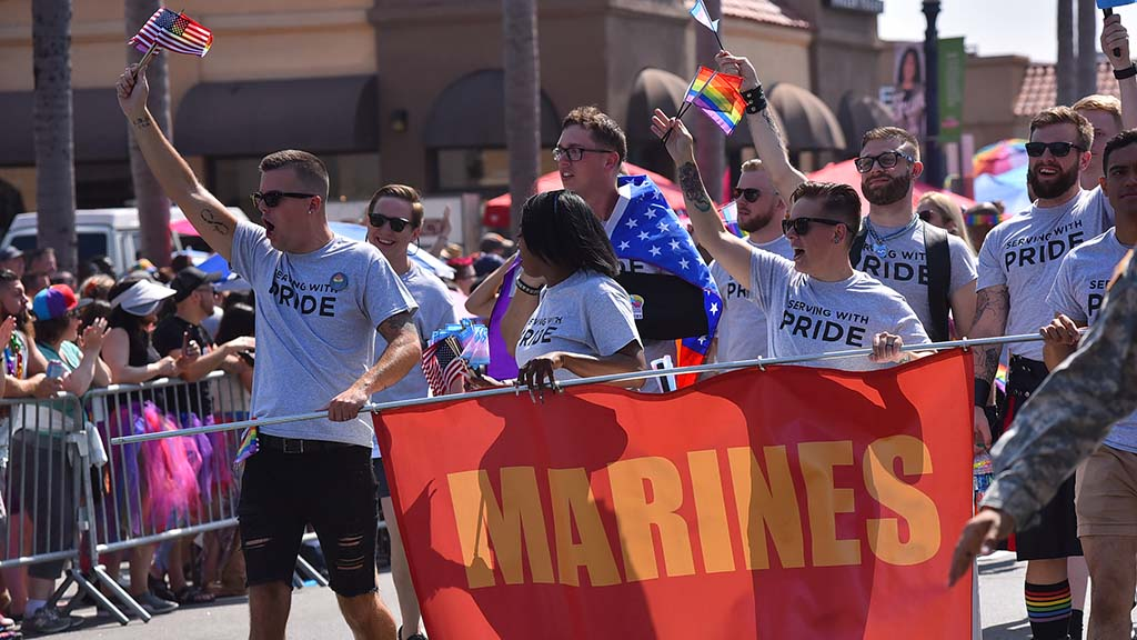 Marines show their support of their LGBT service members. Service members received enthusiastic cheering from the crowd.