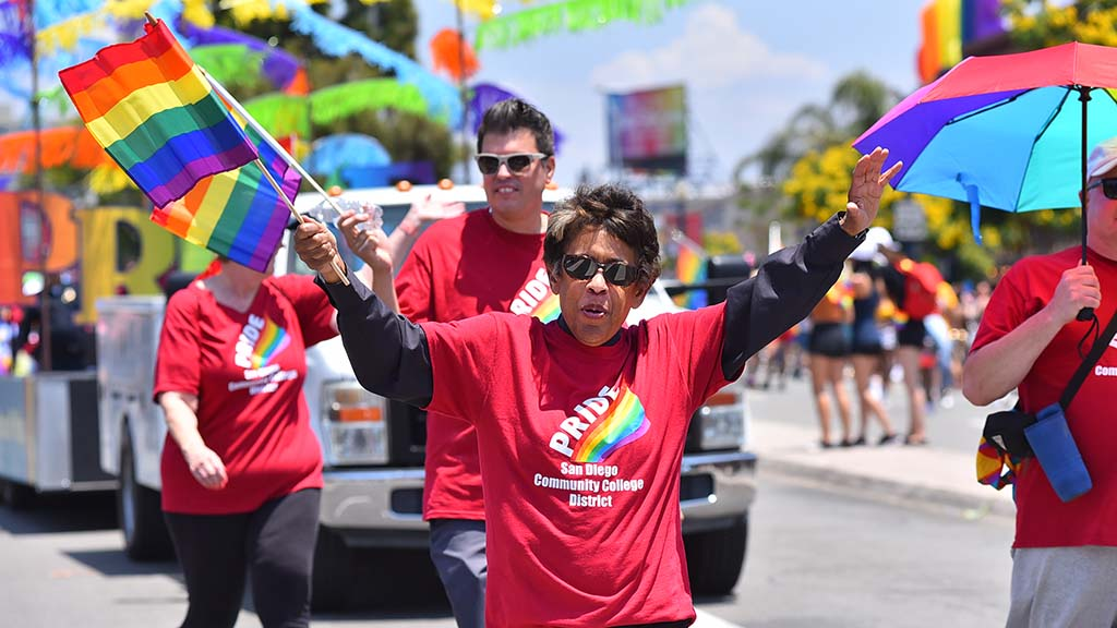 San Diego Community College Chancellor Constance Carroll leads a large group of employees from her district down the parade route.