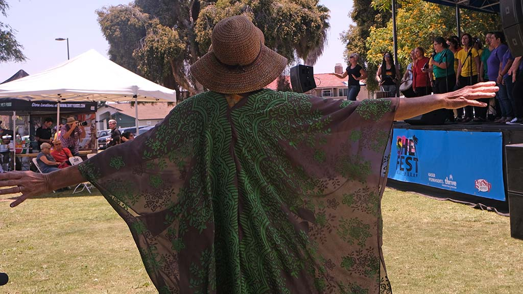 A woman dances as the San Diego Women's Chorus performs at She Fest in North Park.