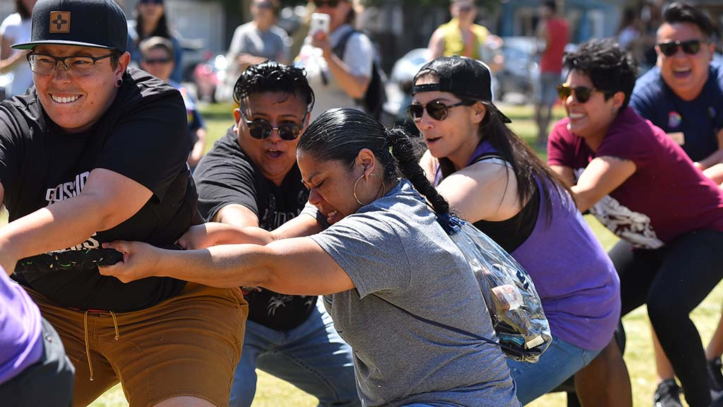 Members of San Diego sports teams have fun with a tug of war with other athletes.