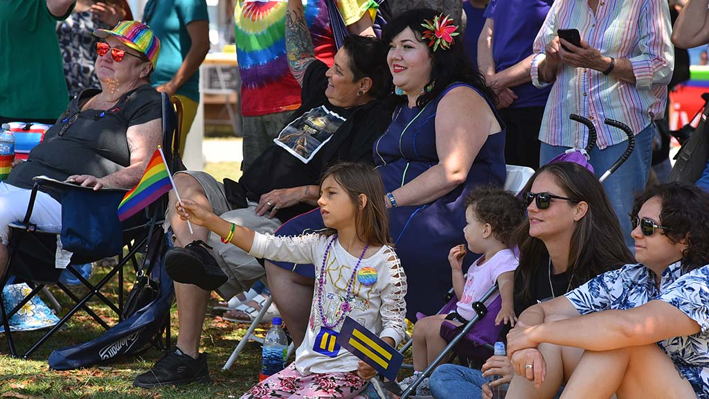 A group of women and children watched the entertainment including a dog fashion contest at She Fest, the beginning of Pride Week in San Diego.