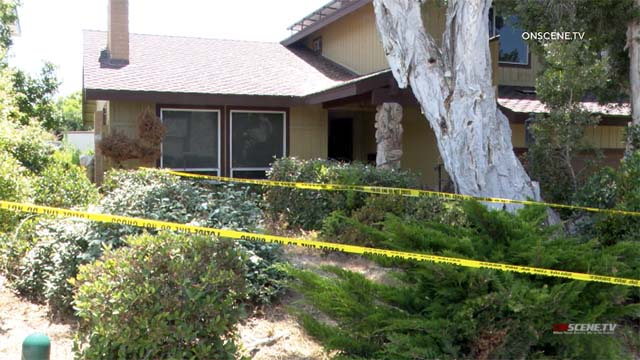 Police tape marks University City home were fatality happened.