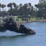 Flames from burning boat off Dana Landing.