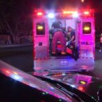 Injured man treated in an ambulance