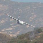 Fire-fighting plane drops retardant