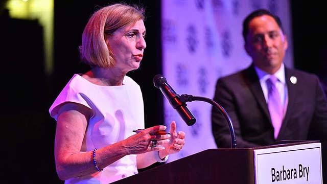 Barbara Bry speaks at San Diego mayoral debate as Todd Gloria listens at San Diego City College.