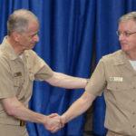 Rear Adm. Paul Pearigen congratulates Capt. Timothy Weber