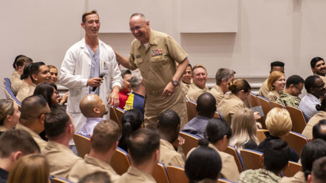 Vice Adm. Forrest Faison shares a laugh with a medical corpsman