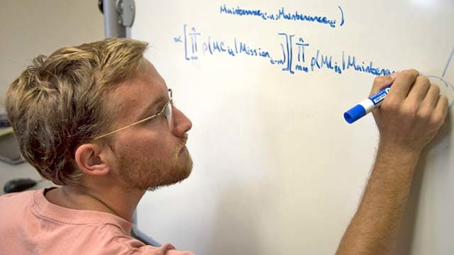 Aj Langley, a UCSD computer sciences graduate student and X-Force fellow, works on his team's data analysis and machine learning project. Langley has been working with a team of students and Sailors from Commander, Naval Air Forces to develop a way to complete predictive aircraft maintenance before the aircraft actually breaks.