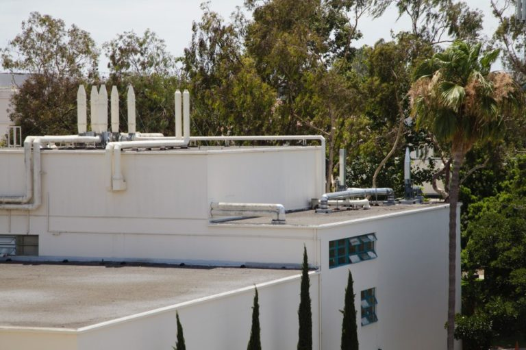 San Diego State University officials closed the Professional Studies and Fine Arts building in mid-March when fumes from a material used to repair the roof sickened people in the building. This photo, taken July 25, 2019, shows the PSFA building's roof.