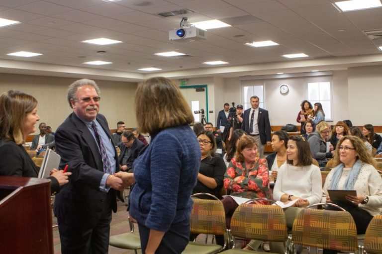 Joel Berman, Vice President of the environmental consulting firm Health Science Associates, shakes hands with San Diego State University President Adela de la Torre at a public forum held during the school's spring break, April 2, 2019.