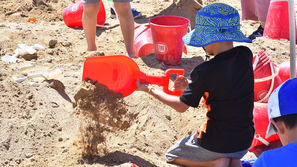 Children had playing in the sand box at the Broadway Pier at the sand sculpting challenge. Photo by Chris Stone