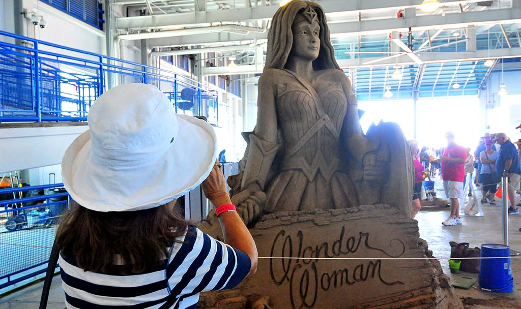"Attendees took photos of the 12 sculptures including ""Wonder Woman"" by John Gowdy. Photo by Chris Stone"