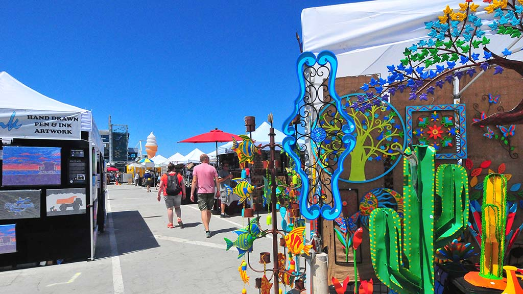The Dimensional Art Exposition at the broadway Pier includes craft and food booths and an entertainment stage. Photo by Chris Stone