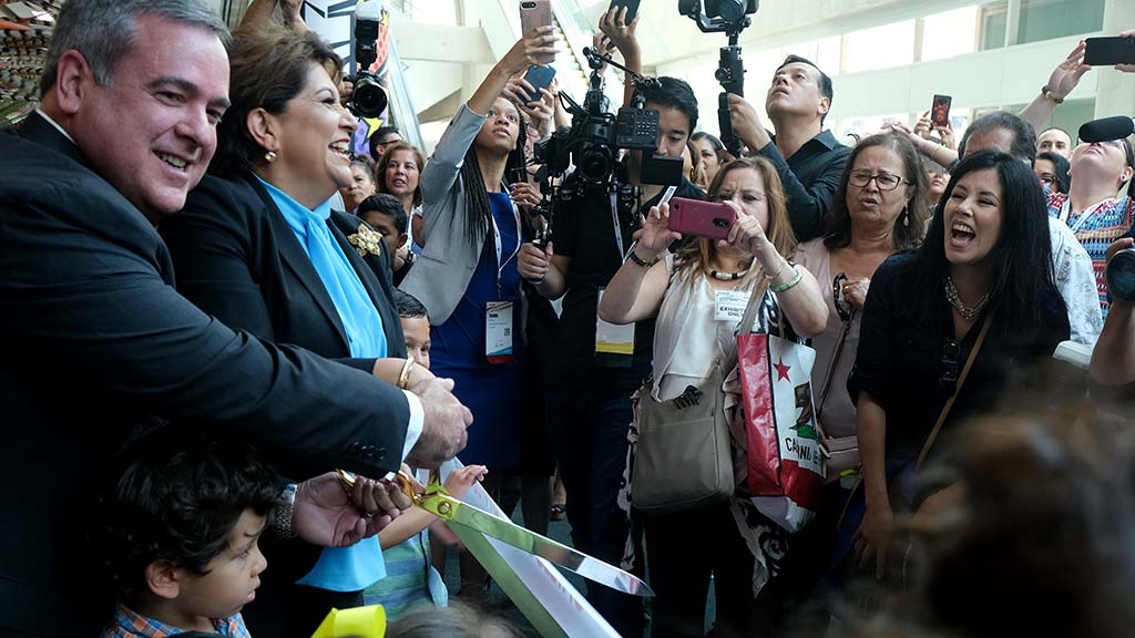 Janet Murguía, president and CEO of UNIDOS, cuts the ribbon to open the 2019 National Latino Family Expo on the second day of the UNIDOS annual conference at the San Diego Convention Center.