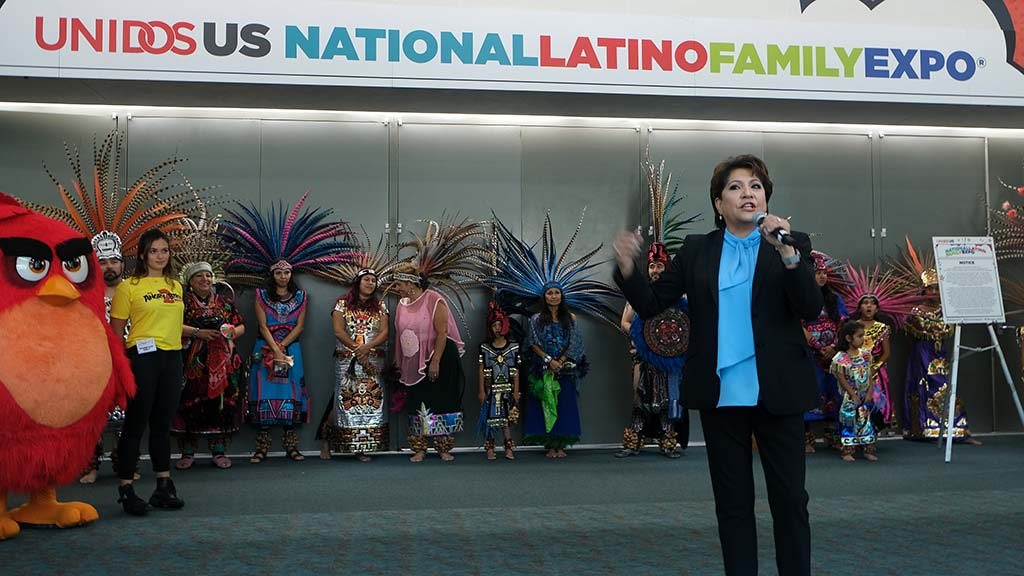 Janet Murguía, president and CEO of UNIDOS leads the opening of the 2019 National Latino Family Expo on the second day of the UNIDOS annual conference at the San Diego Convention Center.