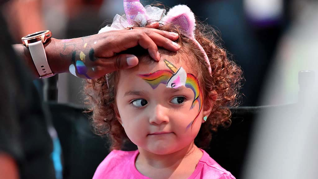 Coachella has her face painted at the 2019 National Latino Family Expo at the convention center. Photo by Chris Stone