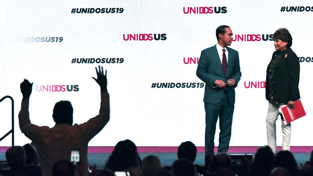 An audience member cheers as UnidosUS President Janet Murguía introduces former Secretary of Housing and Urban Development Julian Castro as the first Hispanic candidate for president.