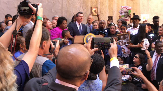 Shirley Weber and Gavin Newsom at the signing ceremony