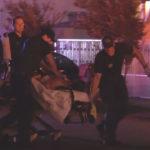 Paramedics rush wounded man to waiting ambulance