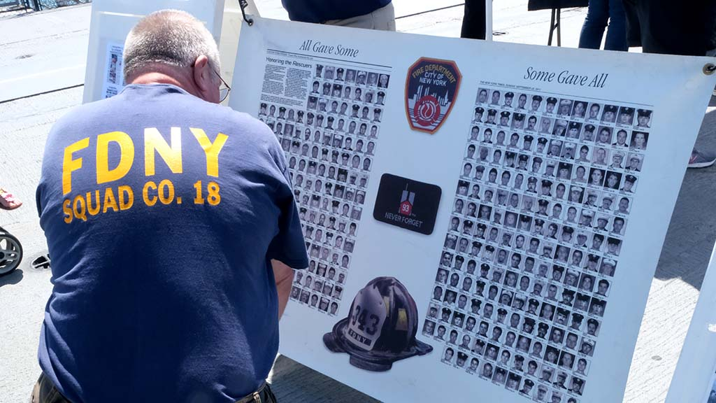 A display on the Midway contained photos of the 343 fallen firefighters in New York City. Photo by Chris Stone