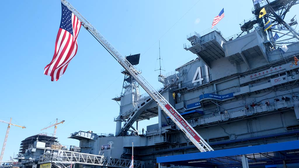 San Diego Fire-Rescue displayed a large flag beside the USS Midway, where the 9/11 remembrance was held. Photo by Chris Stone