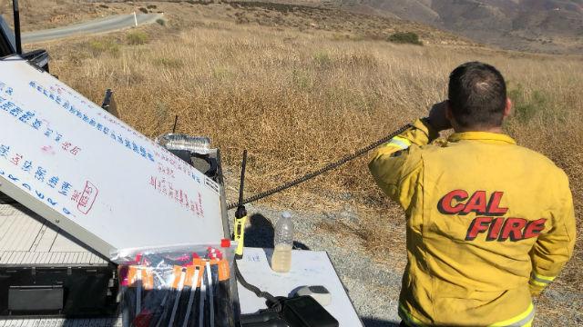 Cal Fire firefighter monitors border fire
