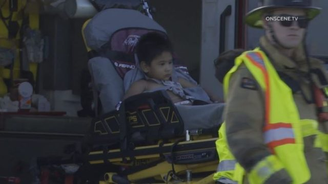 Injured toddler on a stretcher
