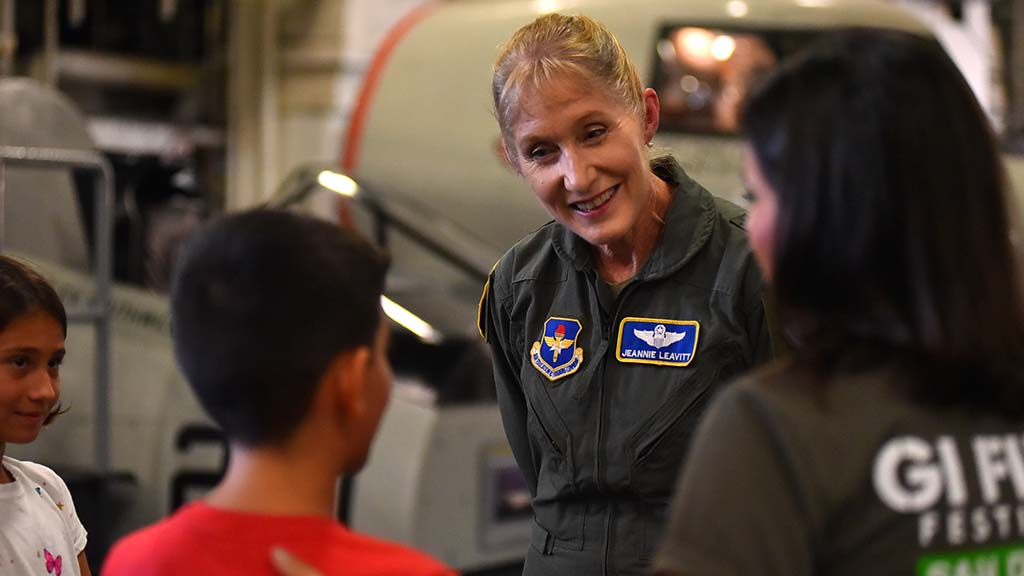 "Maj. General Jeannie Leavitt speaks with a young admirer aboard the USS Midway before the screening of ""Captain Marvel."" Photo by Chris Stone"