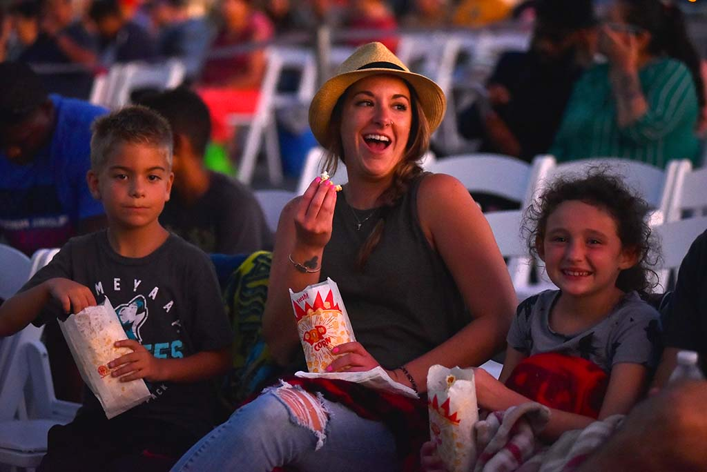 Caree Smail of Texas and her children enjoy a snack aboard the USS Midway before the start of the movie. Photo by Chris Stone