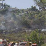 San Diego Fire-Rescue crews battle brush fire