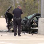 Officer photographs wrecked vehicle