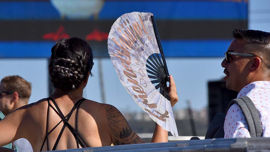Fans and hot weather wear kept people cooler on a hot day at KAABOO Del Mar.