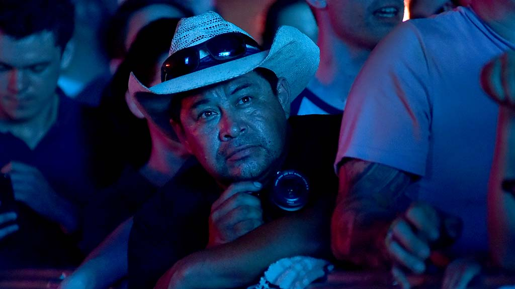 A fan intently watches the Dave Mathews Band at the Sunset Cliffs stage at KAABOO Del Mar.