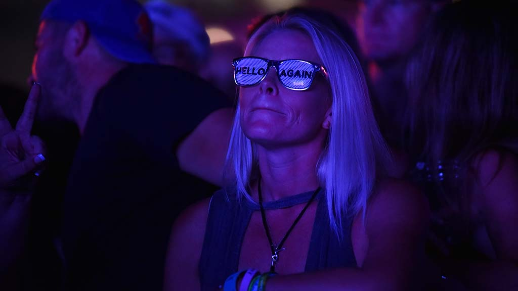 A fan enjoys the beat of the Dave Mathews Band at the Sunset Cliffs stage at KAABOO Del Mar.
