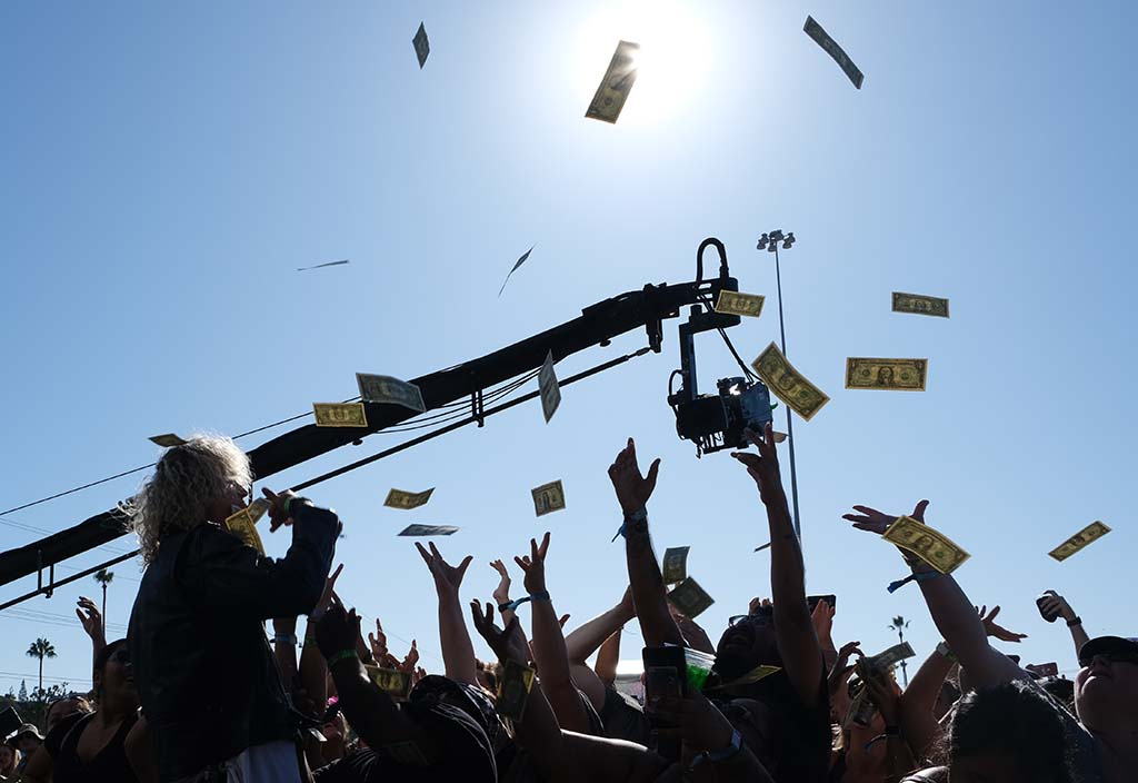 Trevor Dahl of the band Cheat Codes throws the crowd dollar bills at the Sunset Cliffs stage at KAABOO Del Mar.