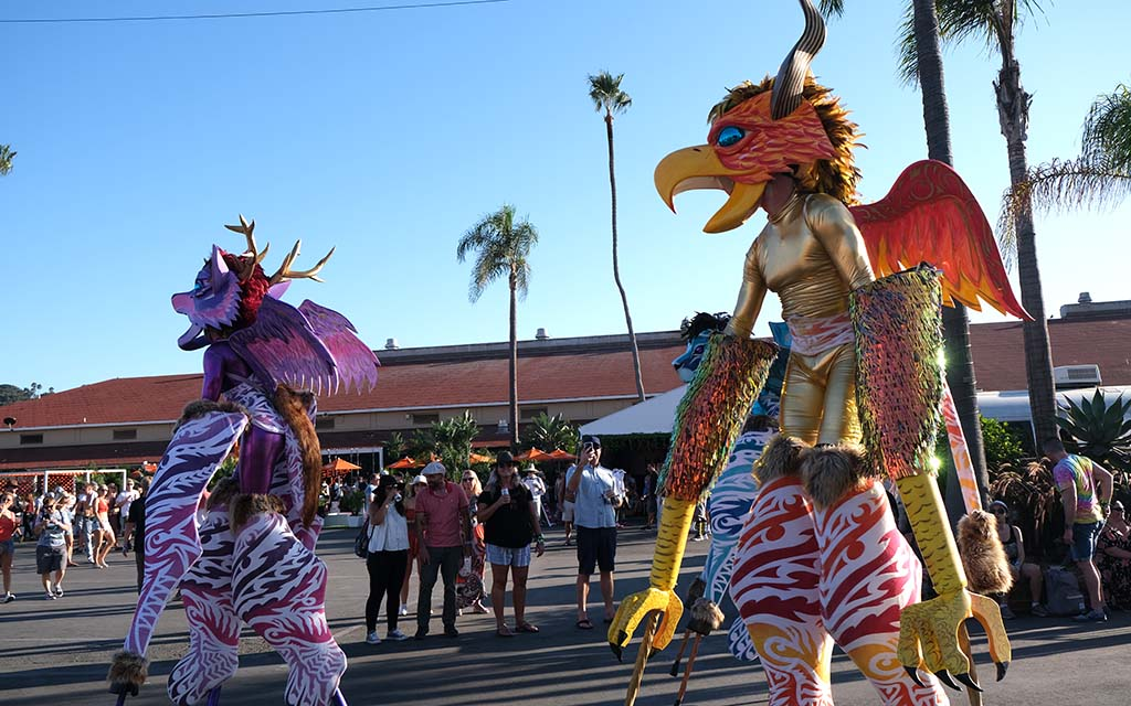Entertainers in whimsical animal costumes on stilts wowed the attendees.